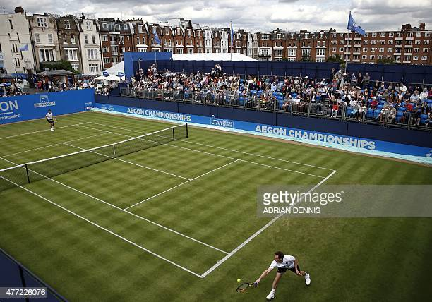 Britain's Andy Murray stretches to play a shot during a practice match on the first day of the ATP Aegon Championships at the Queen's Club in west...