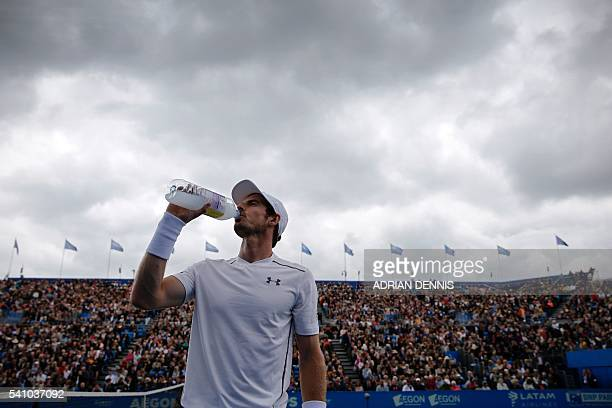 Britain's Andy Murray takes a drink between games during his men's singles semifinal match against Croatia's Marin Cilic in the ATP Aegon...