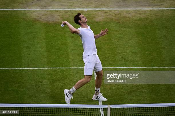Britain's Andy Murray throws his wristband into the crowd as he celebrates winning his men's singles fourth round match against South Africa's Kevin...