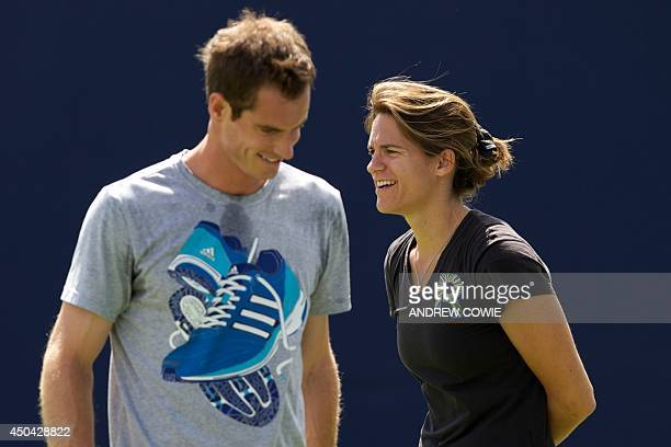 Britain's Andy Murray trains as his newlyappointed French coach Amelie Mauresmo looks on during a practice session at day three of the Aegon...