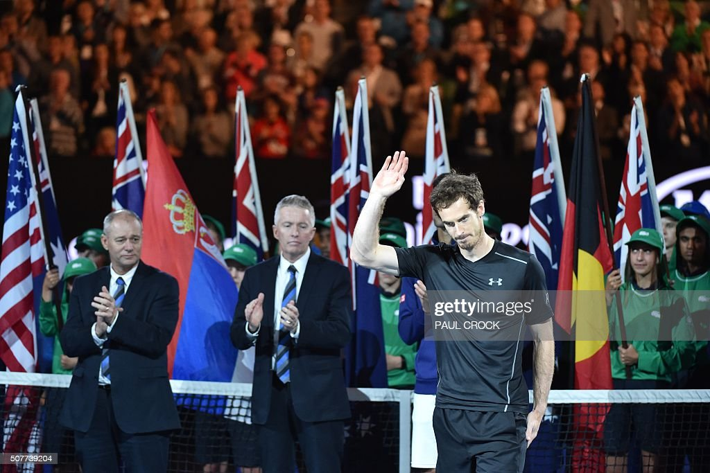 Britain's Andy Murray (R) waves after losing his men's singles final match against Serbia's Novak Djokovic on day fourteen of the 2016 Australian Open tennis tournament in Melbourne on January 31, 2016.