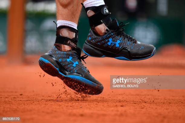 Britain's Andy Murray's shoes are seen as he serves to Russia's Karen Khachanov during their tennis match at the Roland Garros 2017 French Open on...