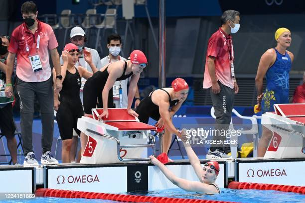 Britain's Anna Hopkin, Freya Anderson, Lucy Hope and Abbie Wood celebrate after winning a heat for the women's 4x100m freestyle relay swimming event...