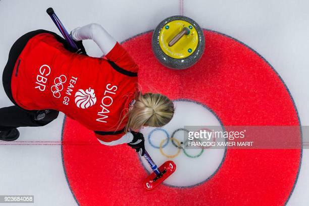 Britain's Anna Sloan brushes the ice during the curling women's bronze medal game between Britain and Japan during the Pyeongchang 2018 Winter...