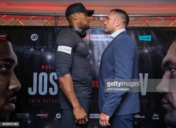 Britain's Anthony Joshua and Bulgaria's Kubrat Pulev pose facing off during a press conference at the Principality Stadium in Cardiff on September 11...
