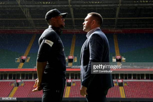 Britain's Anthony Joshua and Bulgaria's Kubrat Pulev stand on the pitch at the Principality Stadium in Cardiff on September 11 2017 during a...
