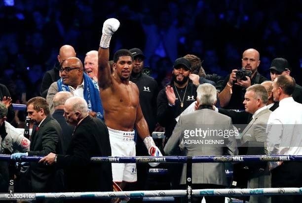 Britain's Anthony Joshua celebrates after defeating Russia's Alexander Povetkin in their boxing world Heavyweight title fight at Wembley Stadium in...