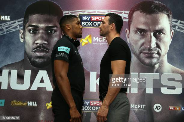 Britain's Anthony Joshua faces off to Ukraine's Wladimir Klitschko during a press conference at Wembley Stadium in north west London on December 14...