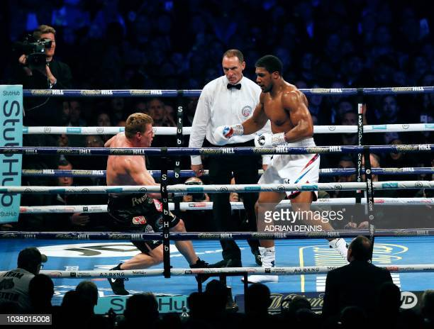 Britain's Anthony Joshua knocks Russia's Alexander Povetkin to the canvas in the 7th round during their boxing world Heavyweight title fight at...