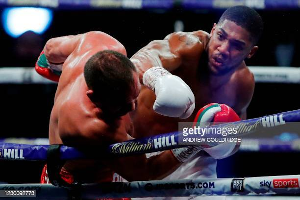 Britain's Anthony Joshua lands a punch on Bulgaria's Kubrat Pulev during their heavyweight world title boxing match at Wembley Arena in north west...