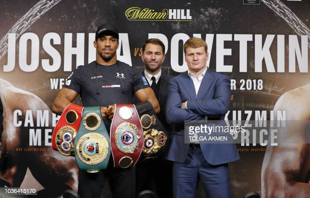 Britain's Anthony Joshua poses by his challenger Russia's Alexander Povetkin during a joint press conference at Wembley stadium in London on...