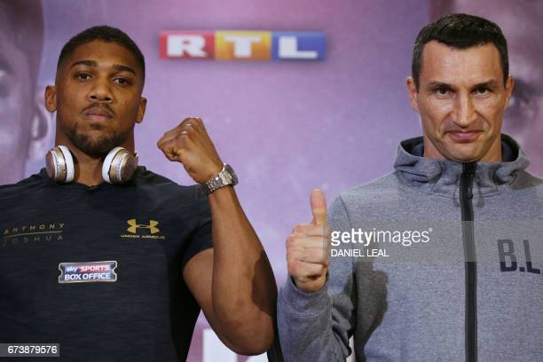 Britain's Anthony Joshua poses by Ukraine's Wladimir Klitschko at Sky broadcasting headquarters in west London on April 27 2017 ahead of their IBF...