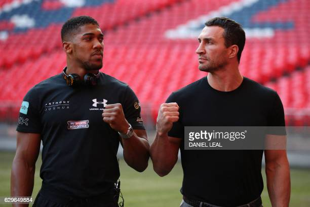 Britain's Anthony Joshua poses with Ukraine's Wladimir Klitschko on the pitch at Wembley Stadium after giving a press conference in north west London...