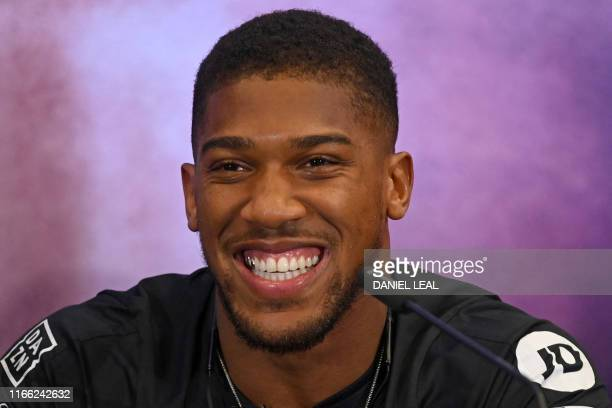 Britain's Anthony Joshua smiles at promotional press conference for the Clash on the Dunes fight against MexicanUS WBA IBF WBO and IBO heavyweight...