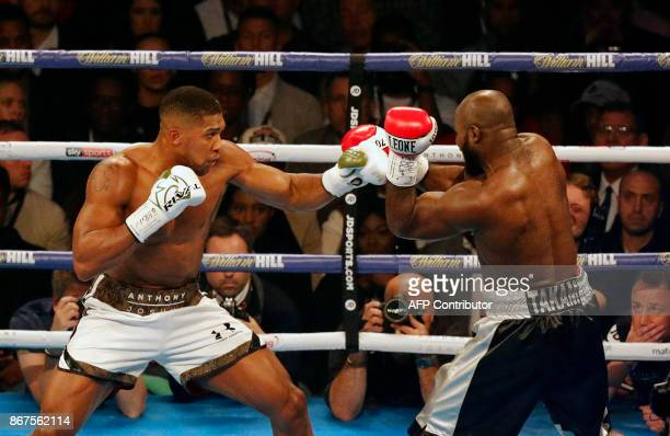 TOPSHOT Britain's Anthony Joshua throws a punch at Cameroonborn Carlos Takam during their world Heavyweight title fight at The Principality Stadium...