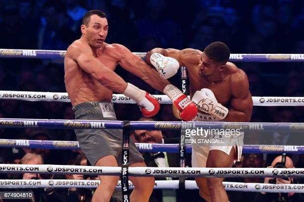 TOPSHOT Britain's Anthony Joshua throws a punch at Ukraine's Wladimir Klitschko during the fourth round of their IBF IBO and WBA world Heavyweight...