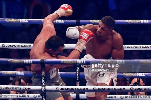 Britain's Anthony Joshua throws a punch at Ukraine's Wladimir Klitschko during the ninth round of their IBF IBO and WBA world Heavyweight title fight...