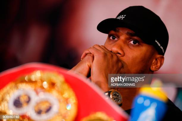 Britain's Anthony Joshua WBA IBF and IBO world heavyweight boxing champion attends a press conference in central London on January 16 2018 to promote...
