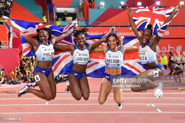 Britain's Asha Philip, Britain's Dina Asher-Smith, Britain's Ashleigh Nelson and Britain's Daryll Neita celebrate silver in the Women's 4x100m Relay...