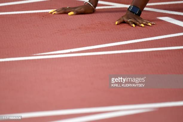 Britain's Asha Philip prepares to compete in the Women's 100m heats at the 2019 IAAF World Athletics Championships at the Khalifa International...
