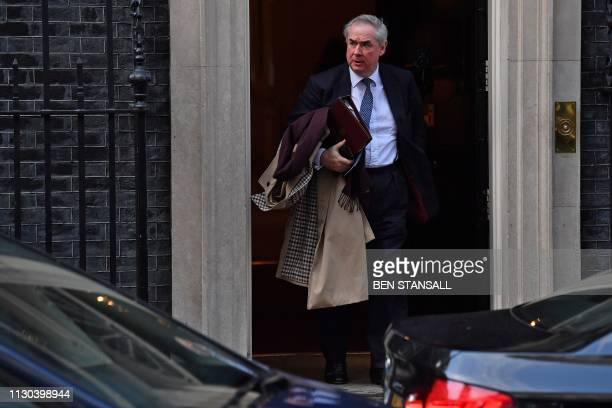 Britain's Attorney General Geoffrey Cox leaves after attending a Cabinet meeting at 10 Downing Street in London on March 14 ahead of a further Brexit...
