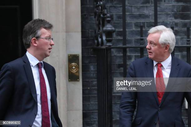 Britain's Attorney General Jeremy Wright and Britain's Secretary of State for Exiting the European Union David Davis leave 10 Downing street in...
