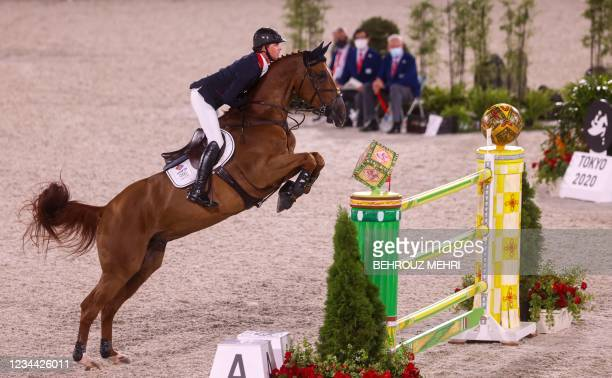 Britain's Ben Maher rides Explosion W in the equestrian's jumping individual qualifying during the Tokyo 2020 Olympic Games at the Equestrian Park in...