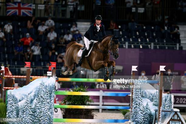 Britain's Ben Maher riding Explosion W in the equestrian's jumping team qualifying during the Tokyo 2020 Olympic Games at the Equestrian Park in...