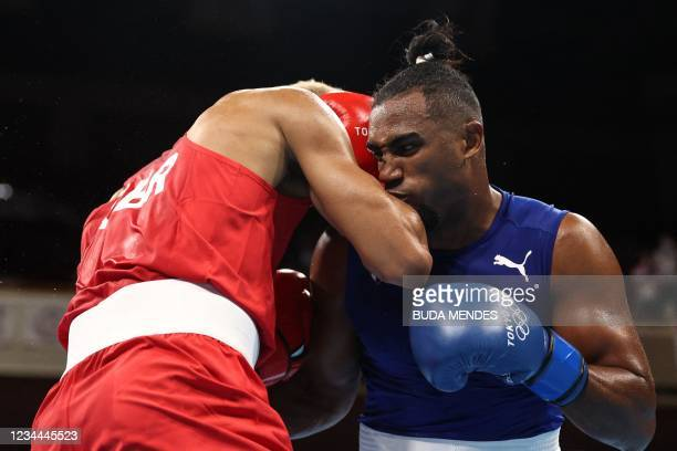 Britain's Benjamin Whittaker and Cuba's Arlen Lopez fight during their men's light heavy boxing final bout during the Tokyo 2020 Olympic Games at the...