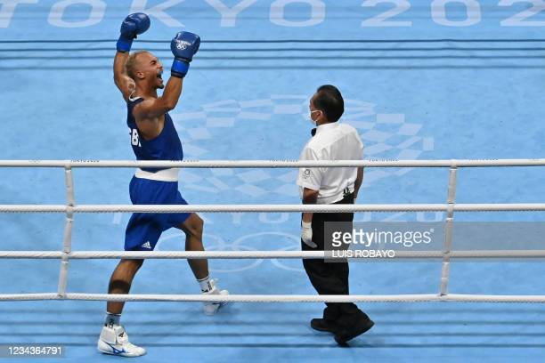 Britain's Benjamin Whittaker celebrates after winning against Russia's Imam Khataev during their men's light heavy semi-final boxing match during the...
