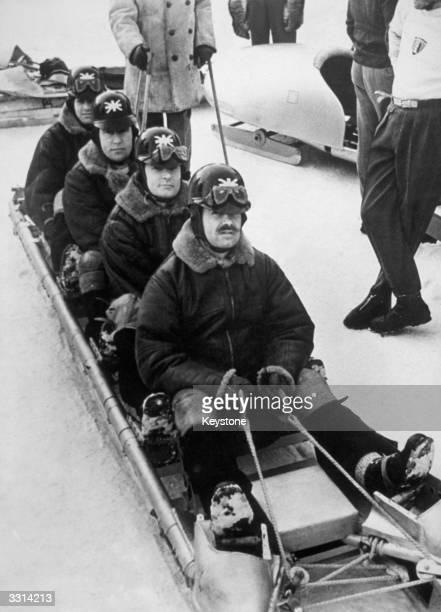 Britain's bob sleigh team prepare for the Cresta Run during their training at the 1948 St Moritz Winter Olympics