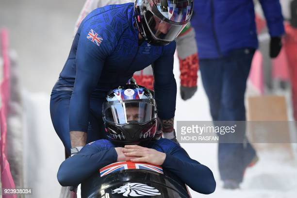 Britain's Brad Hall and his crew react after the 4man bobsleigh heat 4 final run during the Pyeongchang 2018 Winter Olympic Games at the Olympic...