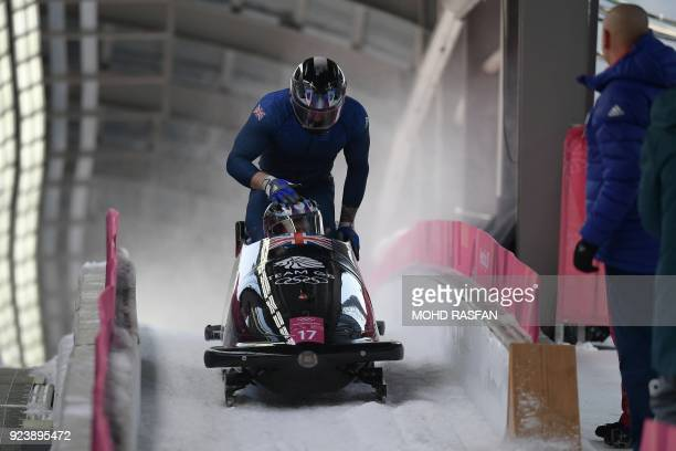 Britain's Brad Hall slows down with his team in the 4man bobsleigh heat 3 run during the Pyeongchang 2018 Winter Olympic Games at the Olympic Sliding...