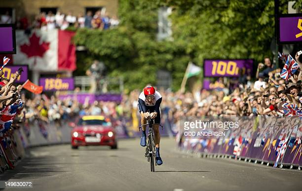 Britain's Bradley Wiggins approaches the finish like to win the gold medal after competing in the London 2012 Olympic Games men's individual time...