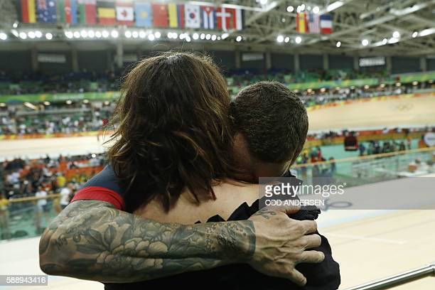 Britain's Bradley Wiggins hugs his wife Catherine Wiggins after winning gold in the men's Team Pursuit finals track cycling event at the Velodrome...