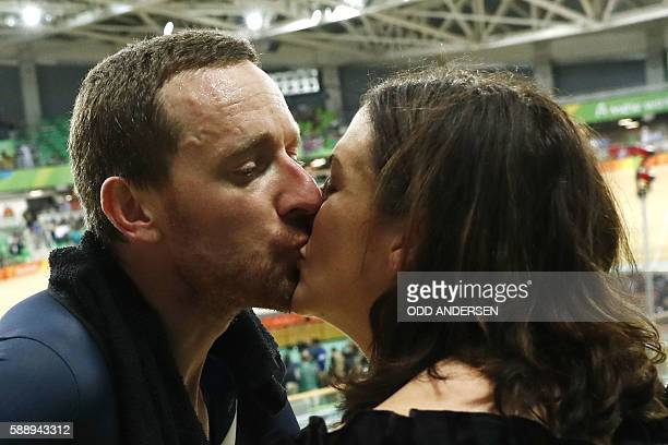 Britain's Bradley Wiggins kisses his wife Catherine Wiggins after winning gold in the men's Team Pursuit finals track cycling event at the Velodrome...