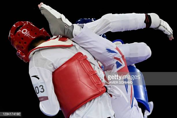 Britain's Bradly Sinden and China's China's Zhao Shuai compete in the taekwondo men's -68kg semi-final round bout during the Tokyo 2020 Olympic Games...