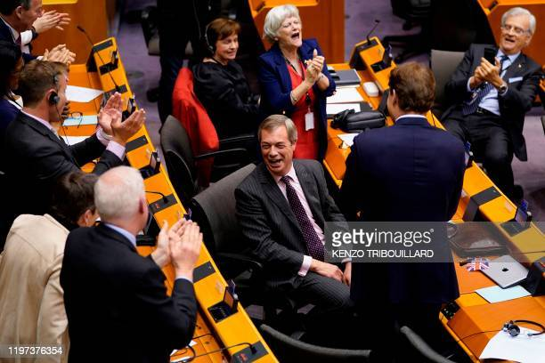 Britain's Brexit Party leader Nigel Farage reacts during a European Parliament plenary session in Brussels on January 29 as Brexit Day is to be set...