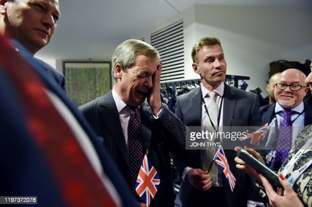 Britain's Brexit Party leader Nigel Farage reacts on the sidelines of a European Parliament plenary session in Brussels on January 29 as Brexit Day...
