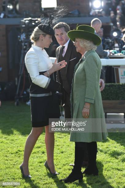 Britain's Britain's Camilla Duchess of Cornwall speaks with retired jockey AP McCoy and his wife Chanelle McCoy during the second day of the...