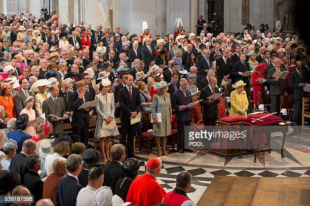 Britain's Britain's Queen Elizabeth II and other members of the royal family and the congregation stand during a national service of thanksgiving for...