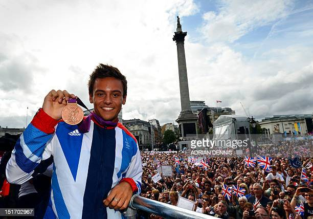 Britain's bronze medal winning diver Tom Daley poses during a parade celebrating Britain's athletes who competed in the London 2012 Olympic and...