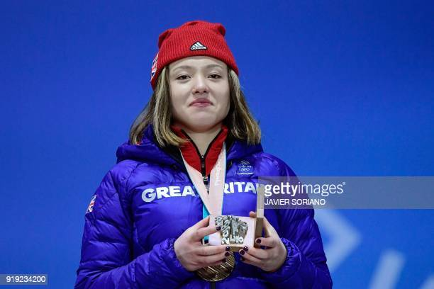 Britain's bronze medallist Isabel Atkin poses on the podium during the medal ceremony for the freestyle skiing women's ski slopestyle at the...
