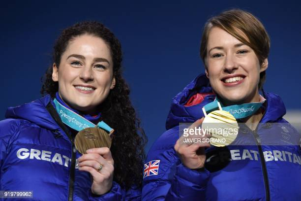 Britain's bronze medallist Laura Deas and Britain's gold medallist Lizzy Yarnold pose on the podium during the medal ceremony for the women's...