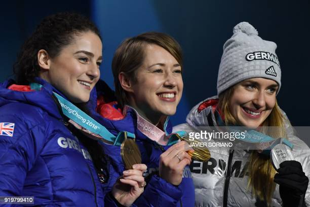 Britain's bronze medallist Laura Deas Britain's gold medallist Lizzy Yarnold and Germany's silver medallist Jacqueline Loelling pose on the podium...