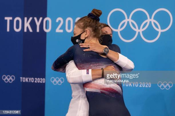 Britain's Bryony Page celebrates with her coach after competing in the women's final of the Trampoline Gymnastics event during Tokyo 2020 Olympic...