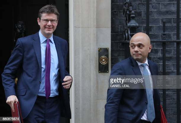 Britain's Business Energy and Industrial Strategy Secretary Greg Clark and Britain's Communities and Local Government Secretary Sajid Javid leave 10...