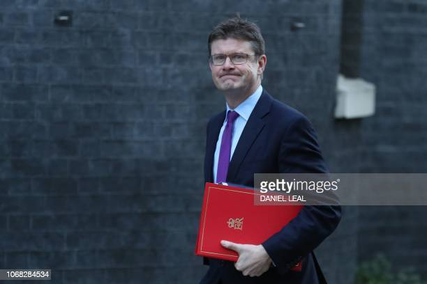 Britain's Business Secretary Greg Clark attends the weekly meeting of the cabinet at 10 Downing Street in London on December 4 2018