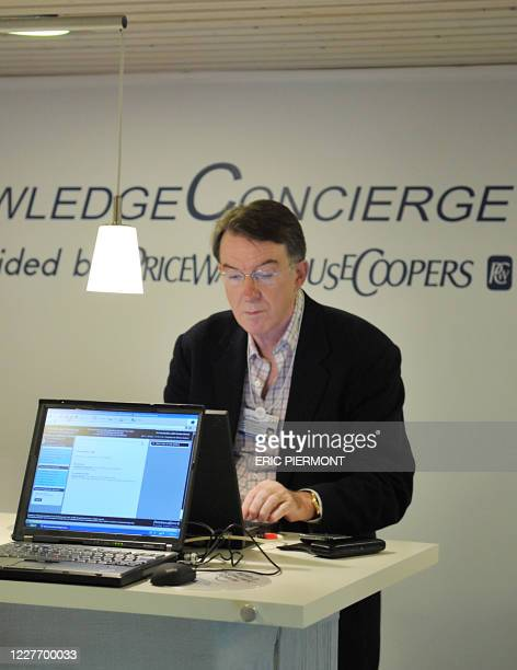 Britain's Business Secretary Peter Mandelson uses a computer in the congress center during the fourth day of the World Economic Forum in Davos...