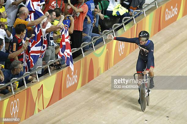 Britain's Callum Skinner celebrates after winning gold in the men's Team Sprint track cycling finals at the Velodrome during the Rio 2016 Olympic...